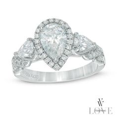 This remarkable ring showcases a 1 CT. pear-shaped diamond center stone wrapped in a sparkling diamond-lined halo frame.