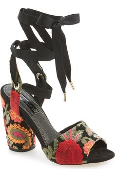Vibrant floral embroidery accents the chunky cylindrical heel and toe strap of this spicy sandal secured by trend-right wraparound laces.