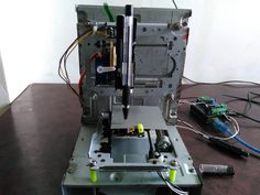 Check this out: How to make mini CNC 2D plotter using scrap DVD drive, L293D by Sandeep Sharma