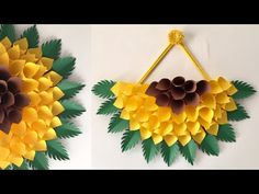 paper sunflower theme wall hanging ideas Material - Cardboard, Tinted paper or chart paper, Glue. If you like my video Plz Li. Paper Wall Hanging, Paper Wall Decor, Wall Hanging Crafts, Diy Wall Decor, Diy Hanging, Hanging Paper Decorations, Paper Flower Art, Paper Flowers Diy, Flower Crafts