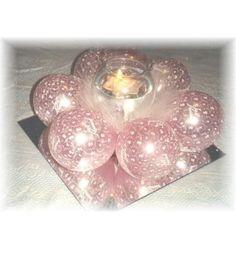 Pale pink balloons and tea light centerpiece