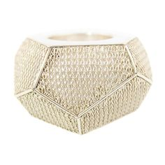 Fit for a superhero, this modern geometric ring manages to be powerful, commanding, and elegant all at the same time.  It features handwoven silver facets on a solid silver ring.  This contemporary mesh jewelry is the result of a very long and organic process.  All pieces are woven entirely by ...
