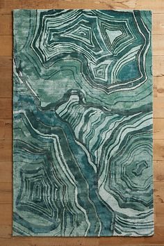 Malachite Rug | Anthropologie - THIS RUG. I've never fallen in love with a rug before, but this one...I love it, love the watery geode look of it.