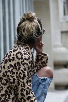animal print sweater and distressed denim.