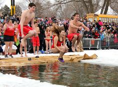 Taking the icy plunge at the Polar Bear Dip at Orillia's Winter Carnival.