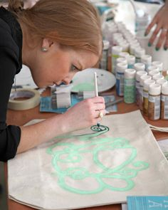 A Painterly Approach   Martha Stewart Living - Instead of stenciling, retail marketing associate Allison Donnelly decided to paint a loopy freehand monogram using mint-green and black craft paint.