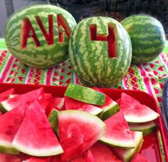 Watermelon theme birthday - watermelons carved with the birthday girl's name and age (cute!!)
