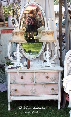 By shabby chateau at the vintage marketplace. I love love how she did the drawers!