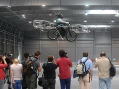 Flying bicycle survives unveiling without horrible crash: Is it a bike? Is it a plane? Three Czech companies have teamed up to make a prototype of an flying bicycle that successfully took off Wednesday inside an exhibition hall in Prague and landed safely after a remote-controlled, five-minute flight.  Looking like a heavy mountain bike, it weighs 95 kilograms. It has two battery-power propellers in the front, two in the back and one each on the sides. A dummy rode in the saddle.