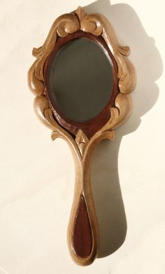 wood carving hand mirror size Hand carved by Athanasia Pastrikou - Mirror Ideas Wood Carving Designs, Wood Carving Patterns, Wood Carving Art, Stone Carving, Into The Woods, Wooden Hand, Wooden Diy, Curved Wood, Mirror Panels