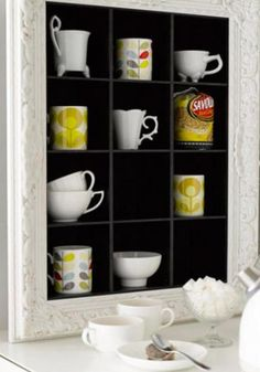Super small kitchen and not enough shelving? Create picture boxes for your cups and glassware.