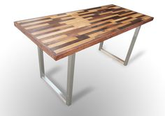 """Clean Contemporary Lines with warm wood tones.  This unique desk will be the centerpiece of any offfice.  Made of 1x2"""" Douglas Fir remnants that are saved from the landfill and repurposed into another table,   The wood's distinctive color differs from table to table, with natural nicks, knots and minor imperfections adding  to the character of each piece.  The wood is finished in a durable low gloss finish..  Top is supported by contemporary brushed steel legs.  Non-Scratch Felt Pads…"""