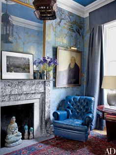 The library features a hand-painted chinoiserie wall mural by Matt Austin and curtains of a Holly Hunt fabric; the portrait over the Edwardian leather armchair is by Hawthorne.