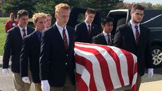 WIN!--Paying their last respects: Michigan teens serve as pallbearers for homeless veterans who would have been buried alone.