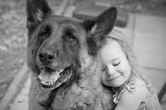 Children feel a great friendship and comfort from a dog or any animal in the family.   This is a perfect picture of the love felt by both human child and canine.