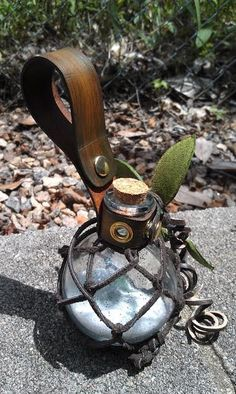 Deluxe Glass Earth Fairy bottle with leather netting and leather frog holster for belt - MADE TO ORDER - Custom by draikairion on Etsy https://www.etsy.com/listing/198112127/deluxe-glass-earth-fairy-bottle-with