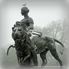 Photo of the Majestic Lion Sculpture on the Victoria Monument, Buckingham Palace, London, United Kingdom