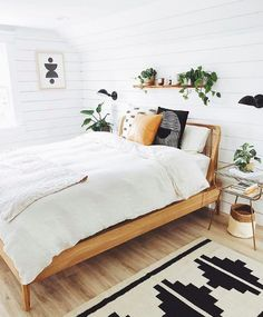 This striking bedroom proves that you don't need an overabundance of color and decor to achieve a boho look if you pay mind to the details.