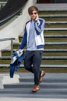 Louis Tomlinson wearing  Adidas Munchen Spzl Shoes, Adidas Originals Superstar Track Top, Sandro Paris Trooper Joggers