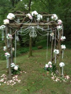 Arbor decor with pearls, miniature chandeliers, blush and white floral decor...