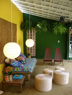 I love the plants up on the wall. Of course my first thought is - how are they watering them without ruining the walls?