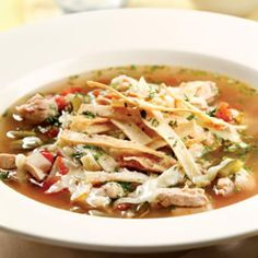 Here's a version of chicken tortilla soup that's both super-easy and delicious. To make it even quicker, use crumbled baked tortilla chips in place of the homemade tortilla strips and skip Steps 1-2. Serve with vinegary coleslaw, lime wedges and hot sauce.