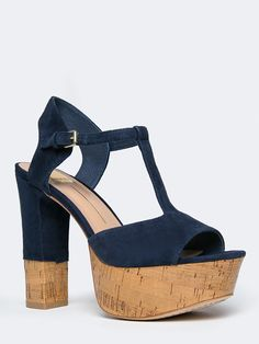 - Put yourself in the limelight with these t-strap sandals! - Suede heels have a cork platform with an open toe design and a buckle closure on the side for an easy going style. - Non-skid sole and cus