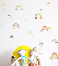 "65 rainbows 2"" - 5.5""w100 tiny triangles - .25""h25 clouds - 1""w - 3""wFully removable and reusable wall decals that will brighten and add character to any room.  **PLEASE NOTE THAT METALLIC VINYL IS NOT REUSABLE**-100% polyester fabric self adhesive vinyl -HP Latex Inks-For best result do not use on textured walls or walls painted with flat paint.  -To clean use damp cloth and warm water.  All of our products are made to order. We do this to insure that you are getting..."
