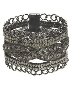 "Easy to put on and with so much style, this bracelet is a must have! It has magnetic ends for an easy and secure closure while the design is edgy all made up of metal with chain links, snake chains and braided mesh embellished with rhinestones.       Bracelet: 7"" length x 2"" width     Metal / Man Made Materials     Imported   Return Policy: Final Sale on this item!"