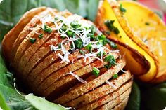 Parmesan Hasselback Baked Potatoes Recipe Side Dishes with potatoes, garlic, olive oil, salt, black pepper, paprika, grated parmesan cheese, chives, sour cream, butter