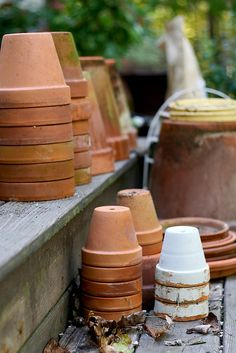 Terra cotta pots at rest awaiting the new spring dreams of a farm girl.