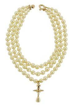 This theatrical yet elegant piece is instantly recognisable as a Vivienne Westwood design. Taking inspiration from historic jewellery, this decorative choker sits close around the neck with the pendular Orb and pearl falling delicately upon mid chest.