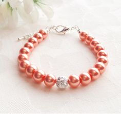Coral Pearl Bracelet Custom Colours Coral Jewelry Coral Bracelet Bridesmaid Gift Wedding by InfinityByClaire on Etsy https://www.etsy.com/listing/228619946/coral-pearl-bracelet-custom-colours