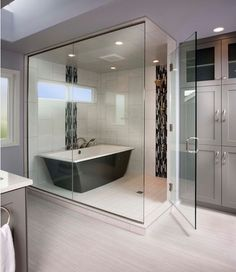 Combining your bathtub within the enclosed shower will save on space while giving you a draft-free bathing experience, especially if you decide on a steam shower enclosure like this design. 2015 Bathtub Trends-From Our Blog at Design Connection, Inc.   Kansas City Interior Design http://www.designconnectioninc.com/inspired-design-top-bathtub-trends-of-2015/
