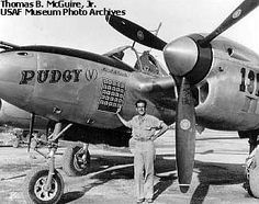 "Major Thomas McGuire of the 431st Fighter Squadron next to his Lockheed P-38J ""Pudgy (V)"""
