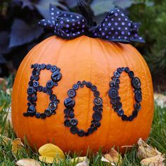 Boo-tiful Button Pumpkin - Paint the pumpkin stem using black crafts paint; let dry. Print a Halloween message in a large font from your computer; cut out individual letters with scissors. Position the letters on the pumpkin, trace around them with a pencil, and remove. Fill each letter with black buttons, adhering them with glue. Tie a black wire-edged ribbon into a bow around the pumpkin stem to finish.