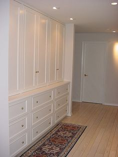 PNB removed the traditional hall closets and added built-in and much more efficient storage.