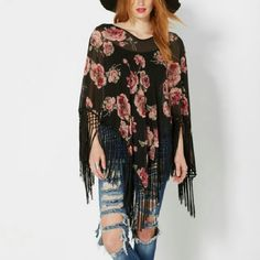 Reduced! Black Floral Exaggerated Fringe Poncho This is a beautiful top and so easy to wear! Black with pretty floral pattern and full fringe. One size fits most. 100% polyester. Sheer. Tops