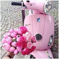 Too cute not to share! Wish this was my mode of transport today! I can totally see my daughter whizzing around our little town on this! Where would you ride this pink Vespa!
