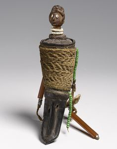 Africa | Amulet ~ 'Mohara Ody' ~ from the Sakalva people of Menabe, Madagascar | Horn (Buffalo), wood, glass beads, and fiber | 20th century