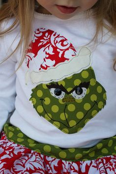 for @Morgan Garza - Grinch applique shirt.  I could totally see you making this!  Or at least if I had a little girl I would pay you to make this for her!