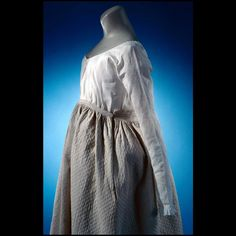 "Petticoat, maternity, quilted white cotton 1780-1795 Origin: England L: 34 1/2""; waist 30 1/2""; circumference 100"" Cotton quilted to cotton with linen thread, cotton batting, linen tape Colonial Williamsburg Acc. No. 1936-666,1"