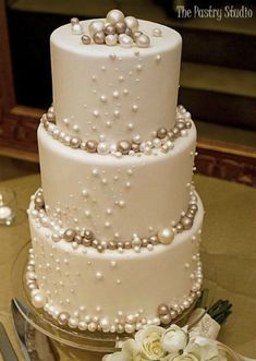 Elegant Wedding Cake with Pearls Photo make the pearls with chocolate covered cheesecake. I love pearls for weddings. So classy and elegant!Source From Pearls Photo make the pearls with chocolate covered the wedding cake. Wedding Cake Pearls, Elegant Wedding Cakes, Beautiful Wedding Cakes, Beautiful Cakes, Amazing Cakes, Dream Wedding, Wedding Simple, Cake Wedding, Trendy Wedding