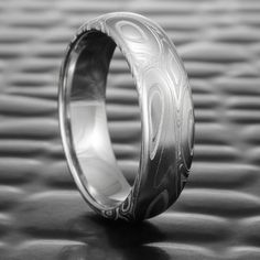 Damascus steel rings hand forged by Steven Jacob. Wood grain and organic Damascus steel pattern wedding bands handcrafted in the USA. Damascus Steel, Damascus Ring, Celtic Wedding Rings, Silver Wedding Bands, Wedding Ring Bands, Wedding Bells, Wedding Bride, Wedding Shoes, Wedding Dresses