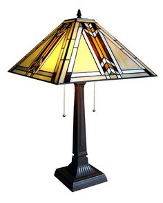 This Arts and Crafts Mission 2 Table Lamp overall height is 23''. The shade is handcrafted with 218 pieces of high quality stained glass and is supported by a resin base finished with an antique bronze patina.