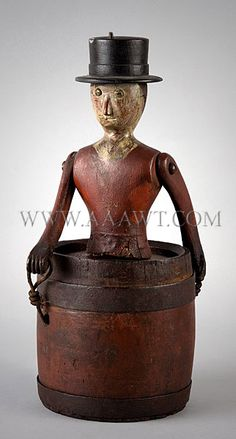 """This figure represents one of the earliest of the rival daredevils who attempted going over Niagara Falls during the first decades of the twentieth century. White pine, carved and painted, iron bands, original painted decoration. The barrel stamped: """"P,.P. + H. Palmer"""" ("""
