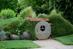 bestofthegarden:    Trying to keep up with your neighbors' gardens? How about adding something they surely don't have — a hobbit house.- Photo from Children's garden at the Oregon Gardens by Quiltsalad (on flickr).