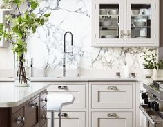 the nickel plate behind the knobs help them so much; the glass front cabinets; and, of course, the marble slab backsplash | Martin Moore & Co.