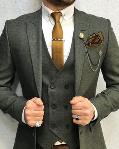 Collection: Spring – Summer 2020 Product: Slim-Fit Wool Suit Color Code: Olive Green Size: Suit Material: wool, polyester Machine Washable: No Fitting: Slim-fit Package Include: Jacket, Vest, Pants Gifts: Chain, Flower and Neck Tie Green Suit Men, Olive Green Suit, Blue Green, Navy Blue, Grey Slim Fit Suit, Wedding Men, Wedding Groom, Christmas Wedding Suits, Men Wedding Suits