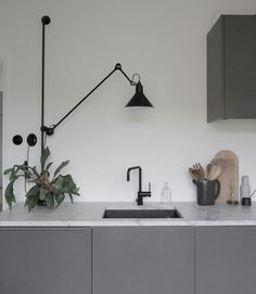 grey kitchen interior The scandinavian kitchen is so beautiful. The design gives you many benefits because it offers a timeless style. Grey Kitchen Interior, Dark Grey Kitchen, Black Kitchen Cabinets, Grey Kitchens, Coastal Interior, Kitchen Counters, Kitchen Islands, Kitchen Lamps, Kitchen Pendant Lighting